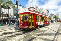 Красный трамвай вагонетки на рельсе Стоковые Изображения