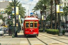 Красный трамвай вагонетки на рельсе Стоковая Фотография