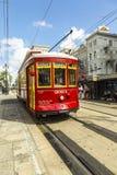 Красный трамвай вагонетки на рельсе Стоковые Фотографии RF
