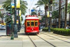 Красный трамвай вагонетки на рельсе Стоковые Изображения RF