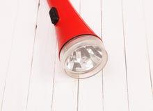 Красный фонарик на белой таблице Стоковое фото RF