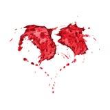 Красный цвет брызгает в форме сердца Стоковое фото RF