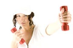 красный цвет девушки гантели Стоковая Фотография RF