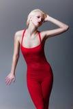 красный цвет девушки красивейшего платья эмотивый Стоковые Изображения RF