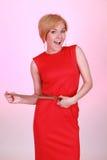 красный цвет девушки платья радостный Стоковое Изображение RF