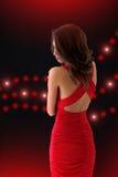 красный цвет девушки платья шикарный Стоковое фото RF