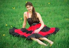 красный цвет девушки платья Стоковое Фото