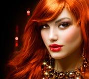 красный цвет девушки с волосами Стоковая Фотография
