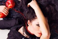 красный цвет девушки яблок ангела темный Стоковые Изображения