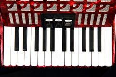 красный цвет детали аккордеони стоковая фотография