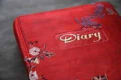 красный цвет дневника крышки книги Стоковые Изображения RF