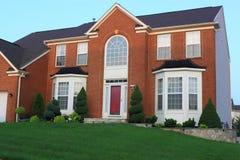 красный цвет дома кирпича Стоковые Фотографии RF