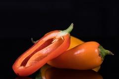 Красный цвет, желтый цвет и оранжевые сладостные перцы изолированные на черноте Стоковая Фотография RF