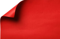 красный цвет завитый углом бумажный Стоковое фото RF