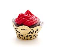 красный цвет замороженный пирожнем стоковое фото rf