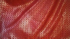 красный цвет золота ткани Стоковое Изображение