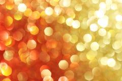 Красный цвет, золото, оранжевая предпосылка искры, мягкие света Стоковое Изображение