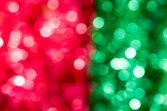 Красный цвет и зеленый цвет запачкали абстрактное backgound света bokeh Стоковые Фотографии RF