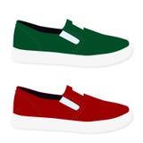 Красный цвет и зеленый цвет покрашенные тапками Стоковое Фото