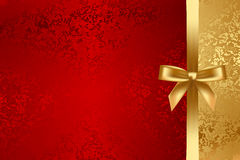 Красный цвет и текстурированная золотом предпосылка с смычком Стоковая Фотография