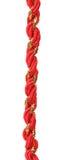 Красный цвет и шнур оборачивать подарка золота стоковая фотография