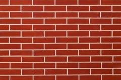 Красный цвет кирпича на предпосылке стены Стоковое Изображение RF
