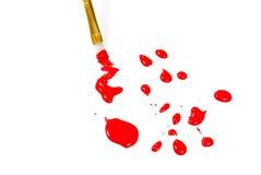 красный цвет краски dops щетки Стоковая Фотография RF