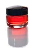 красный цвет лосьона бутылки Стоковое фото RF