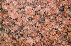 красный цвет макроса гранита предпосылки Стоковые Фотографии RF