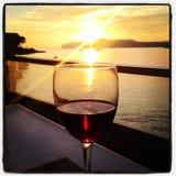 Красный цвет моря захода солнца Стоковые Фото
