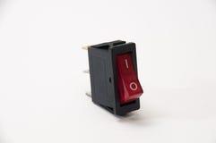 Красный цвет на с переключателе на белой предпосылке Стоковая Фотография RF