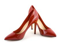 красный цвет обувает женщин стоковое фото rf