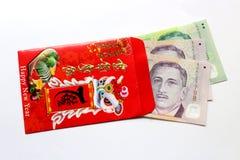 Красный цвет охватывает и удачливый доллар США денег стоковые фотографии rf
