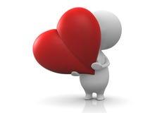 красный цвет персоны владением сердца Стоковая Фотография