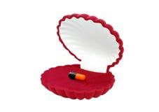 красный цвет пилюльки коробки Стоковая Фотография