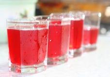 красный цвет питья стеклянный Стоковое Изображение RF