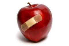 красный цвет поврежденный яблоком Стоковое Фото
