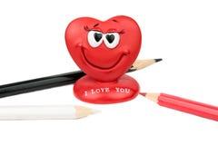 красный цвет предпосылки изолированный сердцем Стоковая Фотография