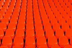 красный цвет предпосылки усаживает стадион Стоковые Изображения RF