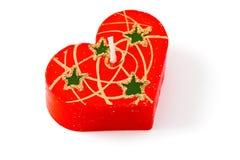 красный цвет путя клиппирования свечки изолированный сердцем стоковые изображения