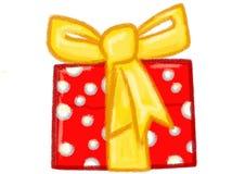 Красный цвет рождества присутствующий с желтым смычком Стоковая Фотография