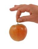 красный цвет руки яблока Стоковая Фотография