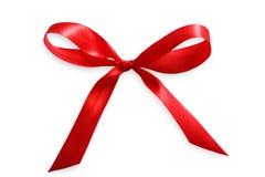 Красный цвет связал вверх ленту сатинировки, концепцию влюбленности дня валентинок Стоковое Фото