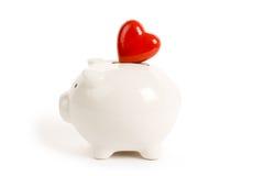 красный цвет сердца банка piggy Стоковая Фотография RF