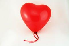 красный цвет сердца воздушного шара Стоковое Изображение RF