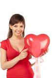 красный цвет сердца девушки воздушного шара Стоковая Фотография RF