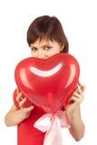 красный цвет сердца девушки воздушного шара Стоковое фото RF