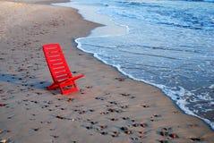 красный цвет стула Стоковые Фото
