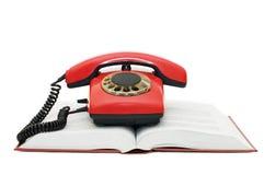 красный цвет телефона книги Стоковое Фото