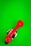 красный цвет телефона удерживания Стоковое Фото